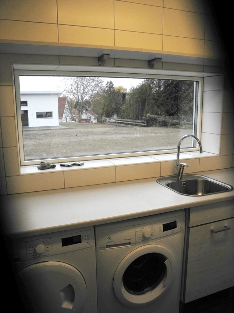 Tvättstuga med tvätt och tork